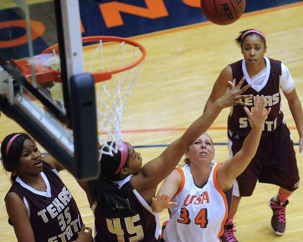 Lyndi Thorman (34) of UTSA shoots a left-handed layup as Ashley Ezeh (45) of Texas State defends during women's college basketball action at UTSA on Saturday, Feb. 16, 2013. Photo: Billy Calzada, San Antonio Express-News / San Antonio Express-News