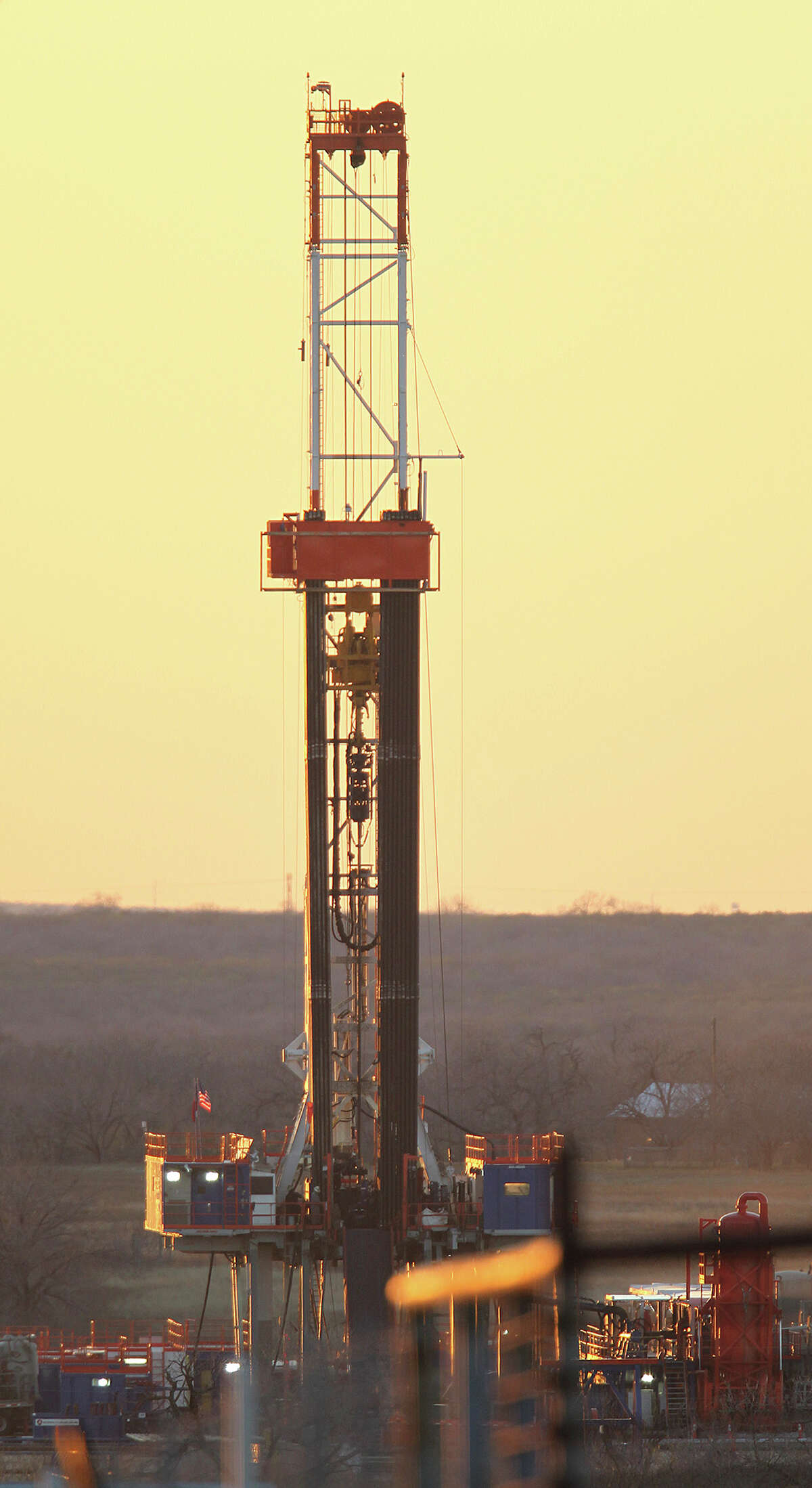 Drilling continues at a Patterson-UTI Energy Rig 248 on FM 99 in Live Oak County near Whisett, Texas, Wednesday, Feb. 13, 2013.