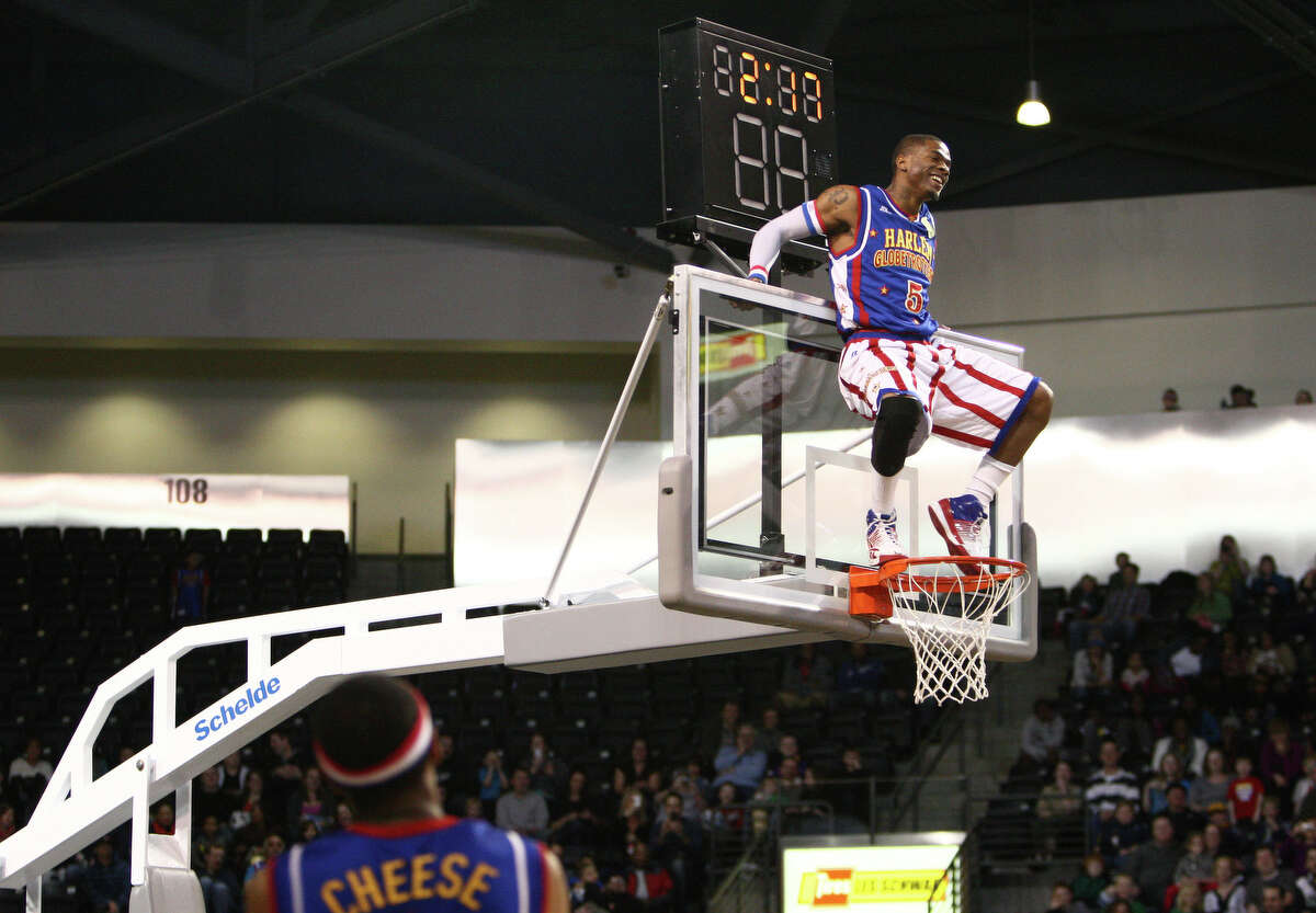 Harlem Globetrotter Crash climbs on the backboard during a performance of the Harlem Globetrotters on Saturday, February 16, 2013 at the Showare Center in Kent. The Globetrotters also have performances scheduled in Everett on Sunday (Feb. 17th) and Seattle on Monday (Feb. 18th) during their tour of the area.