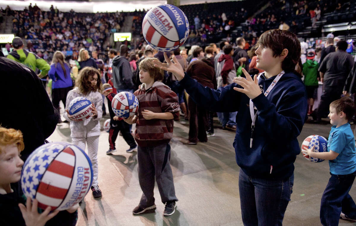Brayden Hester, 13, of Gig Harbor, works on spinning the ball on his finger during halftime of a performance of the Harlem Globetrotters on Saturday, February 16, 2013 at the Showare Center in Kent. The Globetrotters also have performances scheduled in Everett on Sunday (Feb. 17th) and Seattle on Monday (Feb. 18th) during their tour of the area.