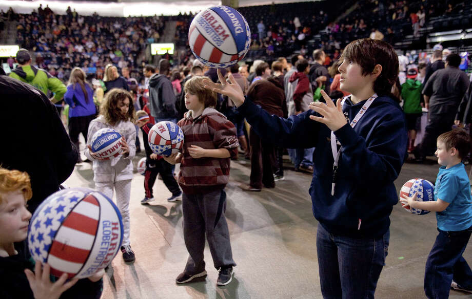 Brayden Hester, 13, of Gig Harbor, works on spinning the ball on his finger during halftime of a performance of the Harlem Globetrotters on Saturday, February 16, 2013 at the Showare Center in Kent. The Globetrotters also have performances scheduled in Everett on Sunday (Feb. 17th) and Seattle on Monday (Feb. 18th) during their tour of the area. Photo: JOSHUA TRUJILLO, SEATTLEPI.COM / SEATTLEPI.COM