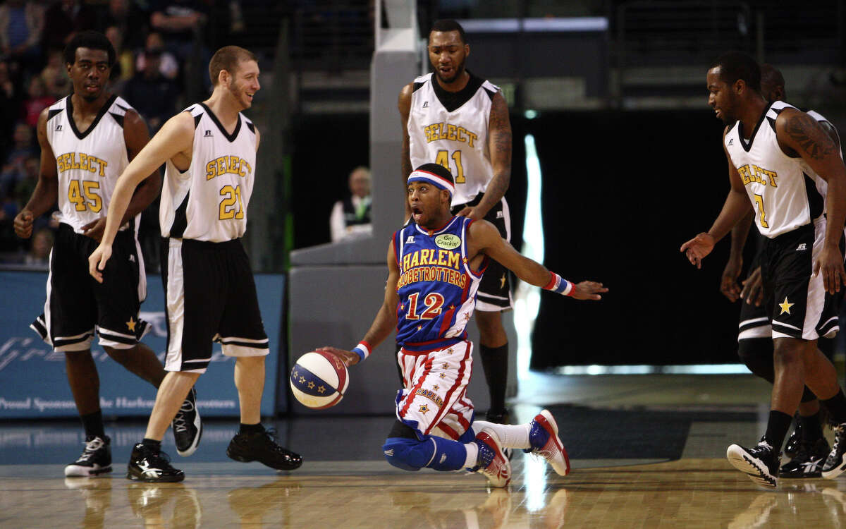 Harlem Globetrotter Ant Atkinson dribbles while on his knees during a performance of the Harlem Globetrotters on Saturday, February 16, 2013 at the Showare Center in Kent. The Globetrotters also have performances scheduled in Everett on Sunday (Feb. 17th) and Seattle on Monday (Feb. 18th) during their tour of the area.