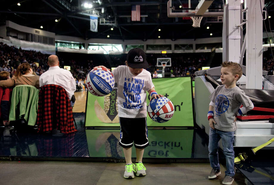 Brandon Arpacilar, 7, works on dribbling two balls during a performance of the Harlem Globetrotters on Saturday, February 16, 2013 at the Showare Center in Kent. The Globetrotters also have performances scheduled in Everett on Sunday (Feb. 17th) and Seattle on Monday (Feb. 18th) during their tour of the area. Photo: JOSHUA TRUJILLO, SEATTLEPI.COM / SEATTLEPI.COM