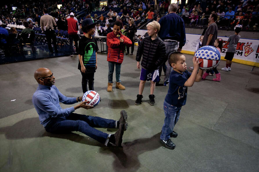 Spectators practice their tricks during halftime of a performance of the Harlem Globetrotters on Sat