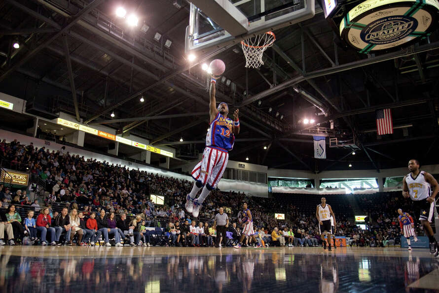 Harlem Globetrotter Ant Atkinson slams the ball during a performance of the Harlem Globetrotters on