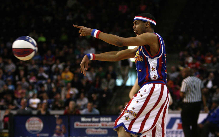 Harlem Globetrotter Ant Atkinson passes the balls during a performance of the Harlem Globetrotters on Saturday, February 16, 2013 at the Showare Center in Kent. The Globetrotters also have performances scheduled in Everett on Sunday (Feb. 17th) and Seattle on Monday (Feb. 18th) during their tour of the area. Photo: JOSHUA TRUJILLO, SEATTLEPI.COM / SEATTLEPI.COM