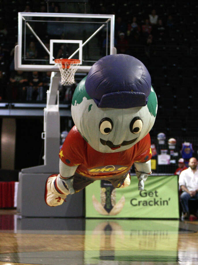 Globie falls to the floor during a performance of the Harlem Globetrotters on Saturday, February 16, 2013 at the Showare Center in Kent. The Globetrotters also have performances scheduled in Everett on Sunday (Feb. 17th) and Seattle on Monday (Feb. 18th) during their tour of the area. Photo: JOSHUA TRUJILLO, SEATTLEPI.COM / SEATTLEPI.COM