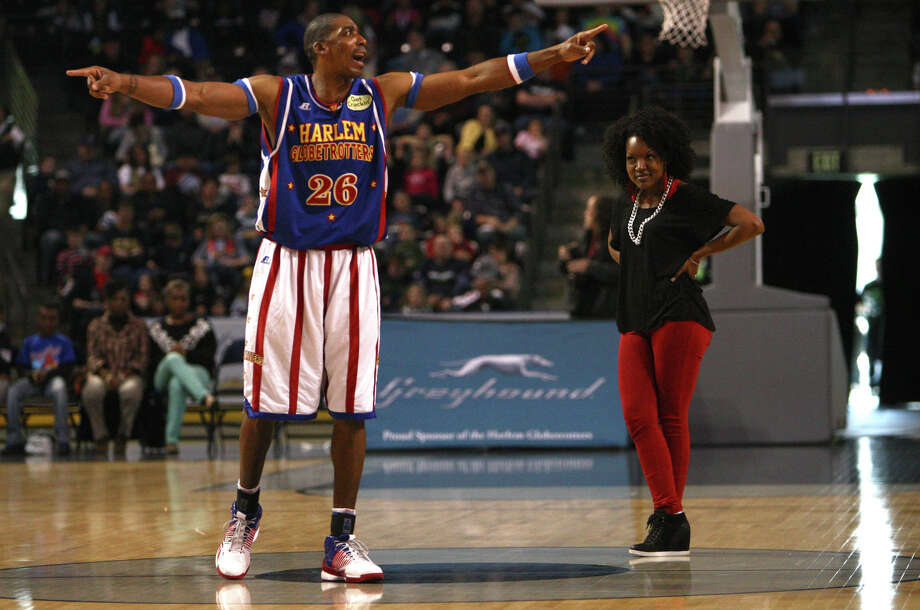 Harlem Globetrotter Hi-Lite Bruton gets the ire of an audience member after swiping her purse during a performance of the Harlem Globetrotters on Saturday, February 16, 2013 at the Showare Center in Kent. The Globetrotters also have performances scheduled in Everett on Sunday (Feb. 17th) and Seattle on Monday (Feb. 18th) during their tour of the area. Photo: JOSHUA TRUJILLO, SEATTLEPI.COM / SEATTLEPI.COM