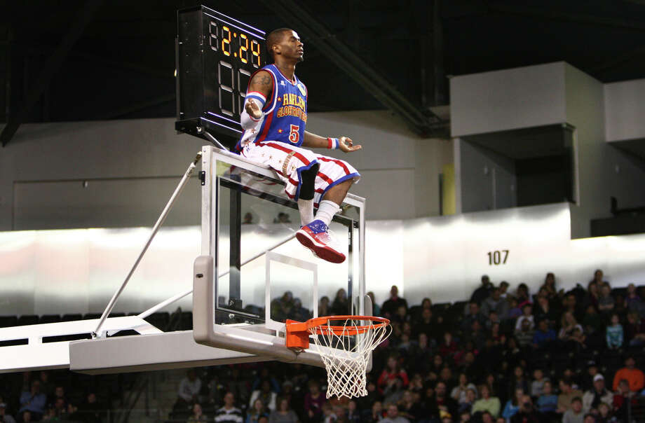 Harlem Globetrotter Crash meditates on the backboard during a performance of the Harlem Globetrotters on Saturday, February 16, 2013 at the Showare Center in Kent. The Globetrotters also have performances scheduled in Everett on Sunday (Feb. 17th) and Seattle on Monday (Feb. 18th) during their tour of the area. Photo: JOSHUA TRUJILLO, SEATTLEPI.COM / SEATTLEPI.COM