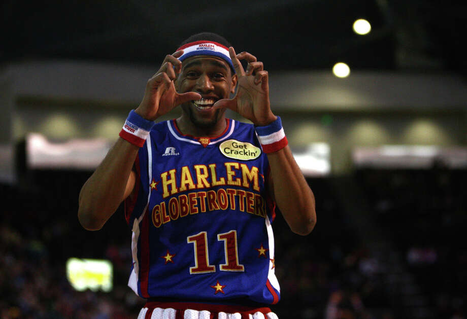 Harlem Globetrotter Cheese Chisholm mimics a photographer during a performance of the Harlem Globetrotters on Saturday, February 16, 2013 at the Showare Center in Kent. The Globetrotters also have performances scheduled in Everett on Sunday (Feb. 17th) and Seattle on Monday (Feb. 18th) during their tour of the area. Photo: JOSHUA TRUJILLO, SEATTLEPI.COM / SEATTLEPI.COM