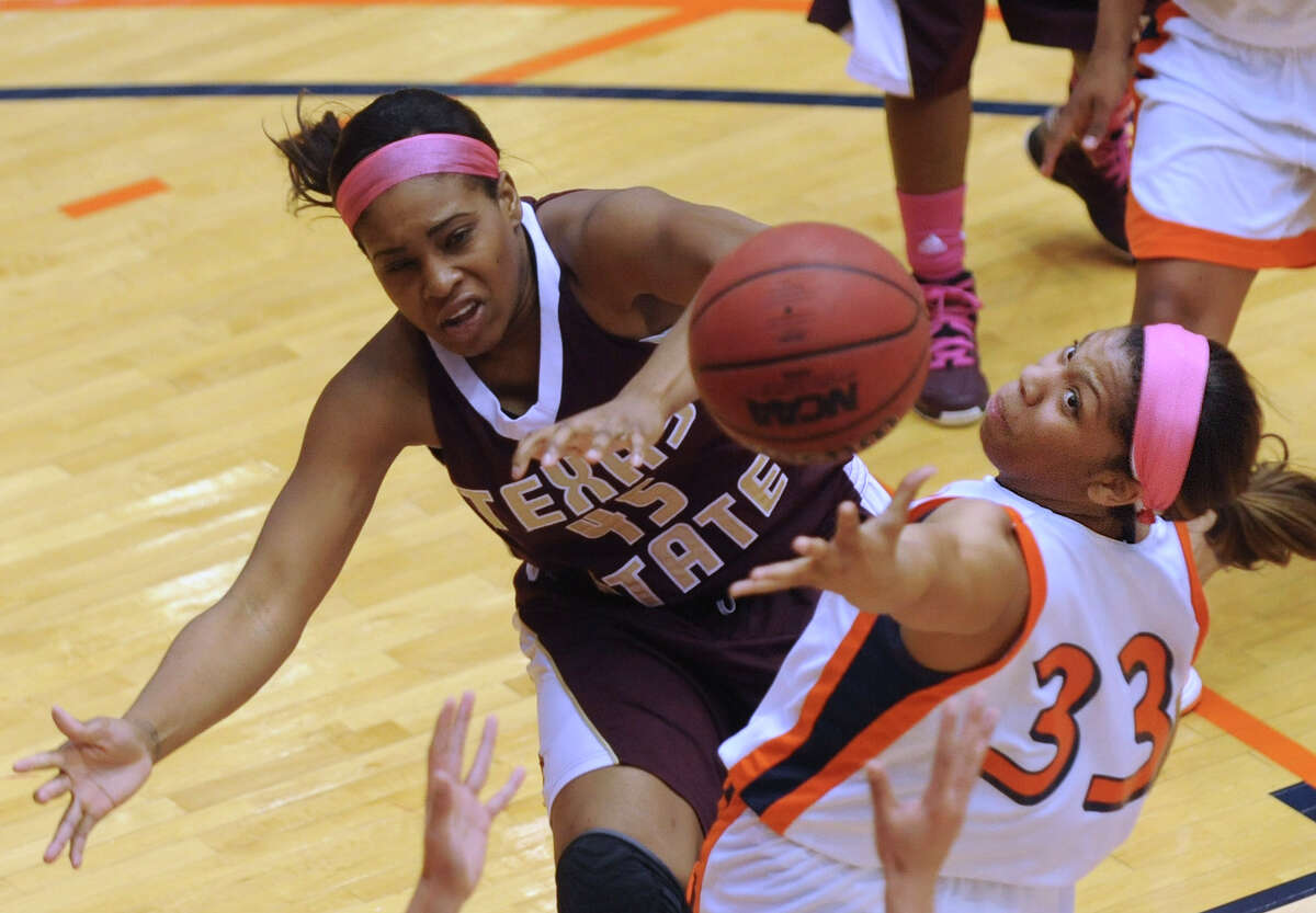 Mannasha Bell, right, of UTSA grabs a rebound as Ashley Ezeh of Texas State defends during women's college basketball action at UTSA on Saturday, Feb. 16, 2013. UTSA won the game, 74-65.