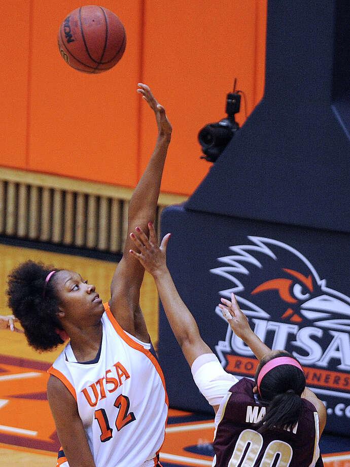 Niaga Mitchell-Cole of UTSA (12) blocks a shot by Kaylan Martin of Texas State during women's college basketball action at UTSA on Saturday, Feb. 16, 2013. Photo: Billy Calzada, San Antonio Express-News / San Antonio Express-News