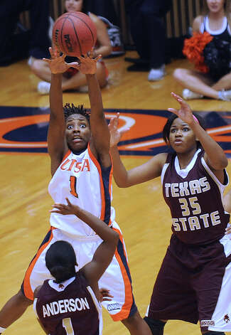 UTSA guard Miki Turner (1) attempts to block a pass by Ayriel Anderson of Texas State to teammate Erin Peoples (35) during women's college basketball action at UTSA on Saturday, Feb. 16, 2013. Photo: Billy Calzada, San Antonio Express-News / San Antonio Express-News