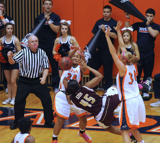 Ashley Ezeh (45) of Texas State is fouled by Ashley Spaletta (24) of UTSA as teammate Lyndi Thorman (34) assists during women's college basketball action at UTSA on Saturday, Feb. 16, 2013. UTSA won the game, 74-65. Photo: Billy Calzada, San Antonio Express-News / San Antonio Express-News