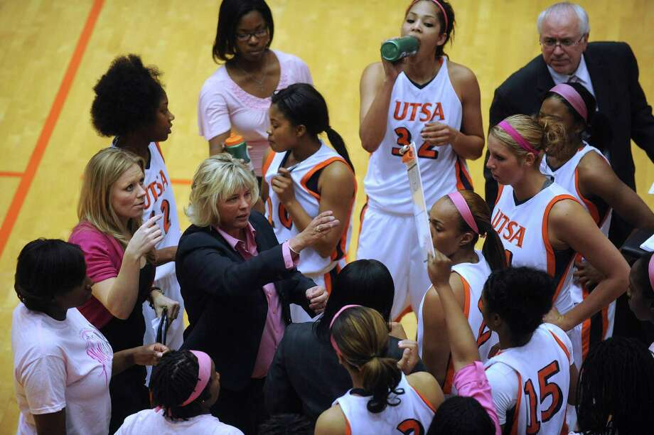 UTSA head coach Rae Rippetoe-Blair, middle in dark jacket, speaks with her team during a timeout against Texas State at UTSA on Saturday, Feb. 16, 2013. UTSA won the game, 74-65. Photo: Billy Calzada, San Antonio Express-News / San Antonio Express-News