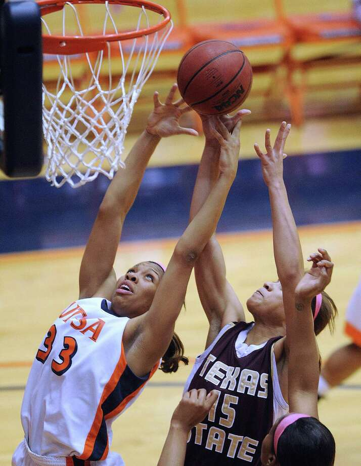 Freshman forward Mannasha Bell of UTSA  battles for a rebound against Jasmine Baugus of Texas State on Saturday, Feb. 16, 2013. Photo: Billy Calzada, San Antonio Express-News / San Antonio Express-News