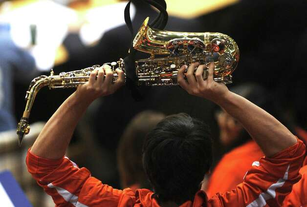 A UTSA pep band saxophonist cheers during women's college basketball action against Texas State at UTSA on Saturday, Feb. 16, 2013. Photo: Billy Calzada, San Antonio Express-News / San Antonio Express-News