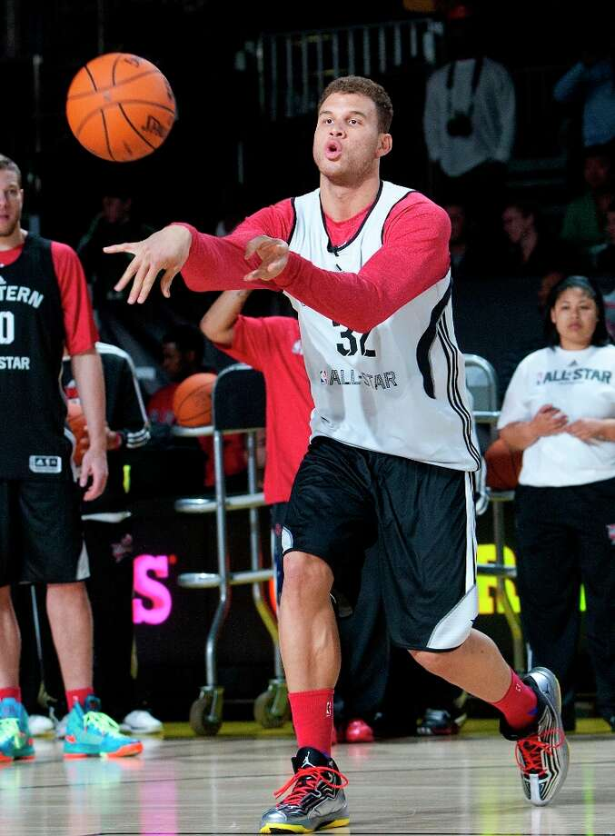 LA Clippers Blake Griffin passes the ball during All-Star practice at the George R. Brown Convention Center, Saturday, Feb. 16, 2013, in Houston. Photo: Cody Duty / © 2013 Houston Chronicle