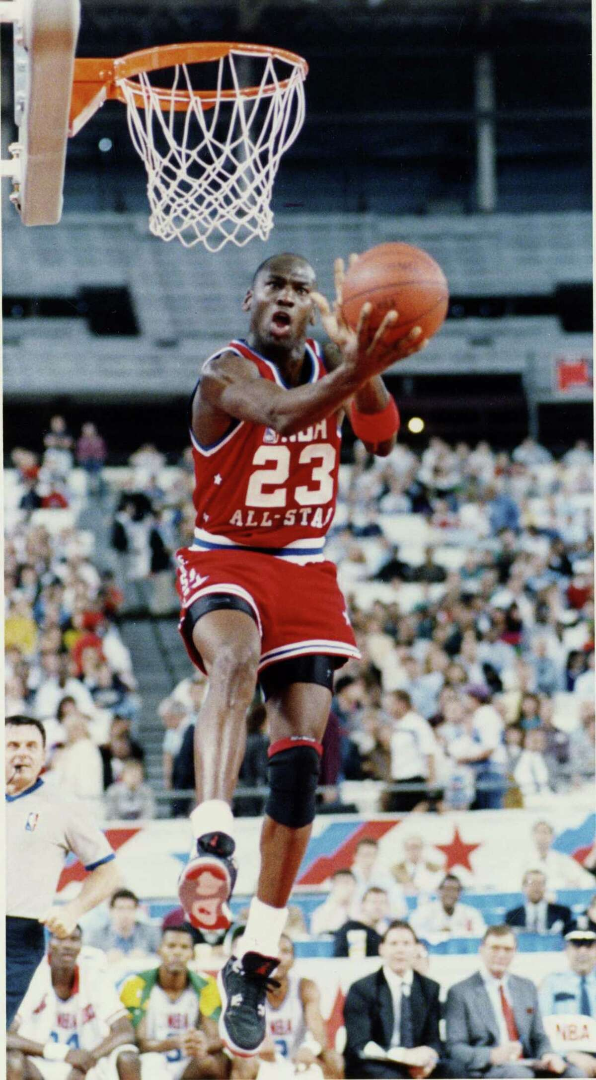 02/12/1989 - NBA ALL STAR GAME AT ASTRODOME - Chicago Bulls Michael Jordan takes the ball to the hoop.