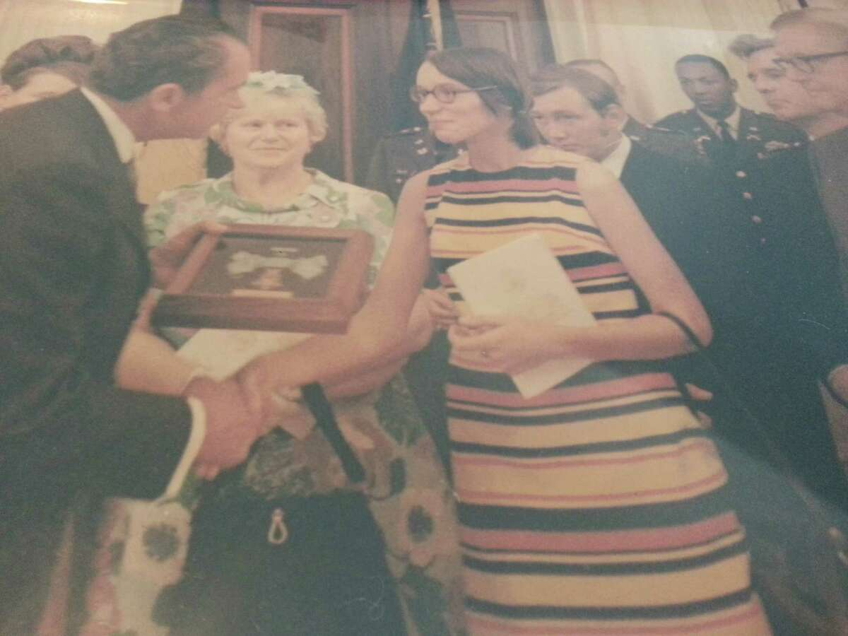 President Richard Nixon posthumously awarded Army Specialist Peter Guenette of Troy the Medal of Honor. Here the president hands the nation?s highest military award to Guenette?s wife, Susan Guenette Fisher, on April 7, 1970. Fisher gave the medal to Guenette?s mother, Mildred, shown in the center.?