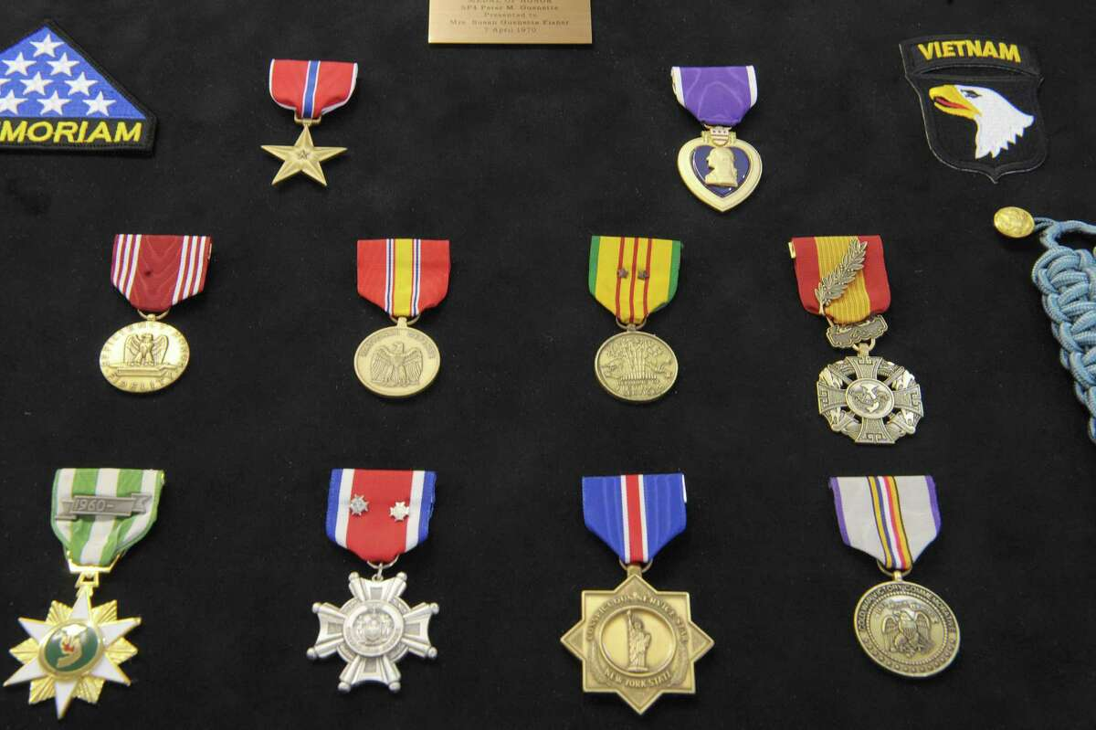 A view of some of the medals that are part of a framed display case for the Vietnam War medals of Peter Guenette being created at Country Outlet Framing on Monday, Feb. 11, 2013 in Delanson, NY. Peter Guenette died after he threw himself on an enemy grenade to save his fellow soldiers. Guenette is the last person from the Capital Region to receive a Medal of Honor. (Paul Buckowski / Times Union)