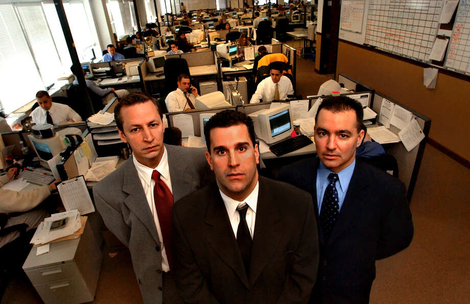 Times Union staff photo by Cindy Schultz -- Owner/broker on record Christopher Lang, center, senior vice president Paul Bardwell, left, and consultant David Silipigno, right, pose in the salesroom of First Guarantee Mortgage on Wednesday, Dec. 18, 2002, in Saratoga Springs, N.Y. (TO GO WITH BOYER STORY) Photo: CINDY SCHULTZ / ALBANY TIMES UNION