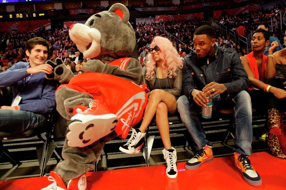 Cleveland Cavaliers guard Daniel Booby Gibson, right, sits with Keysia Cole and Rockets mascot Clutch as they war the NBA All-Star Shooting Stars competition at the Toyota Center on All-Star Saturday Night, Saturday, Feb. 16, 2013, in Houston. Gibson is from Houston, where he played at Jones High School before the University of Texas. Photo: Melissa Phillip / © 2013  Houston Chronicle