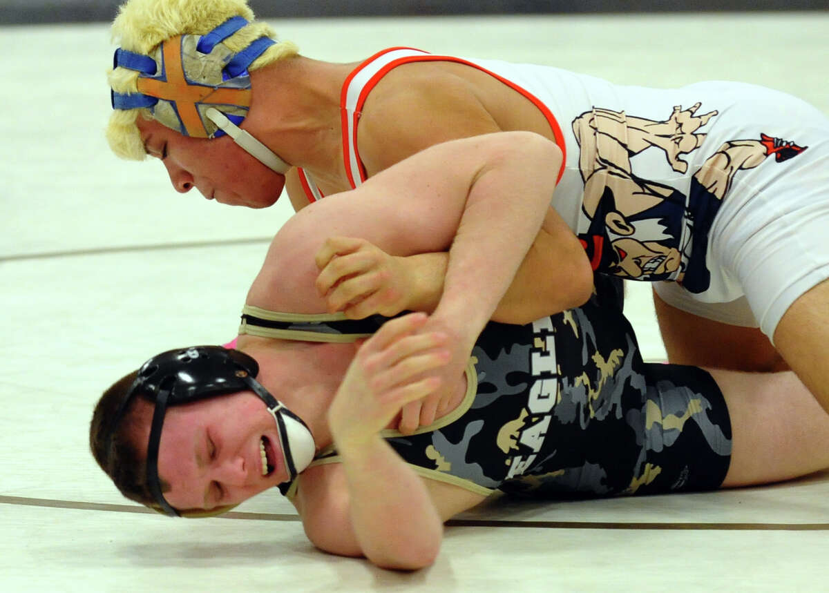Danbury's Juan Garcia works to turn over Trumbull's Brandon Fulco, during Class LL wrestling championship wrestling action in Trumbull, Conn. on Saturday February 16, 2013.