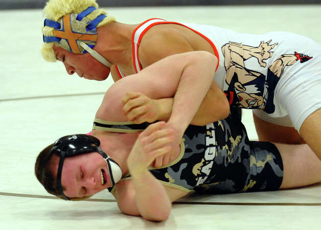 Danbury's Juan Garcia works to turn over Trumbull's Brandon Fulco, during Class LL wrestling championship wrestling action in Trumbull, Conn. on Saturday February 16, 2013. Photo: Christian Abraham / Connecticut Post