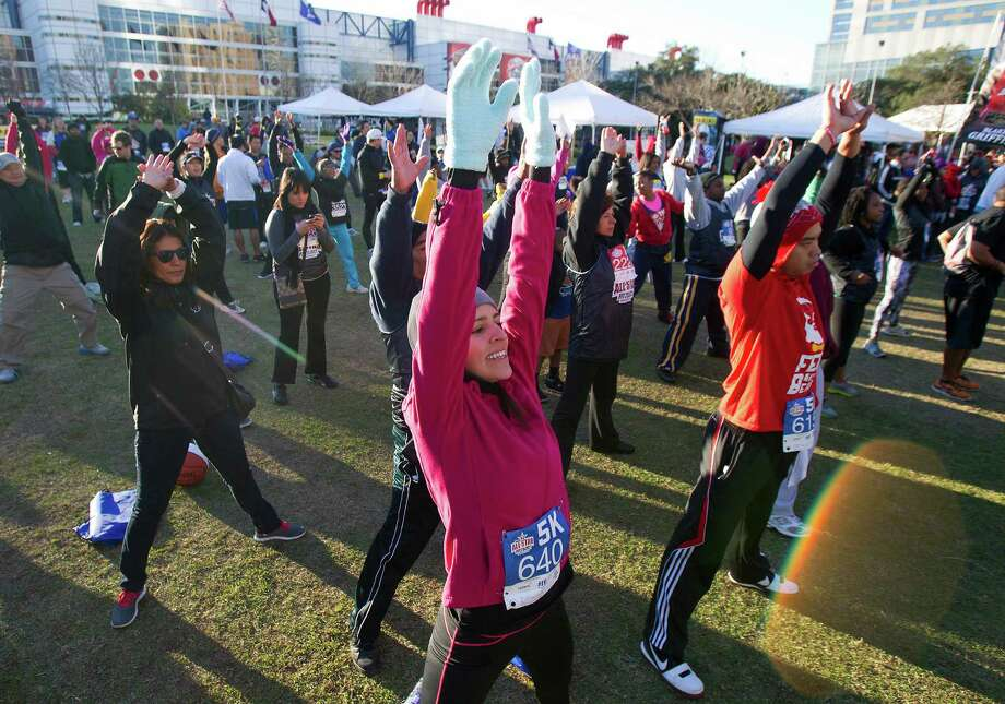 Contestants warm up before the All-Star FIT, Walk & Dribble, at Discovery Green, Saturday, Feb. 16, 2013, in Houston. Photo: Cody Duty, Houston Chronicle / © 2013 Houston Chronicle