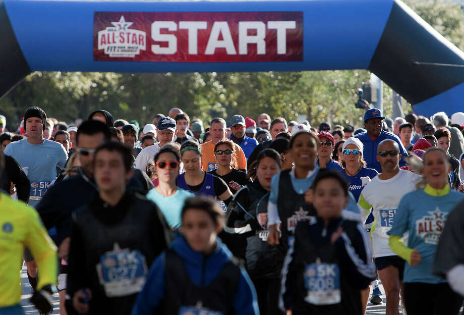 Contestants run a 5k during the All-Star FIT, Walk & Dribble, at Discovery Green, Saturday, Feb. 16, 2013, in Houston. Photo: Cody Duty, Houston Chronicle / © 2013 Houston Chronicle