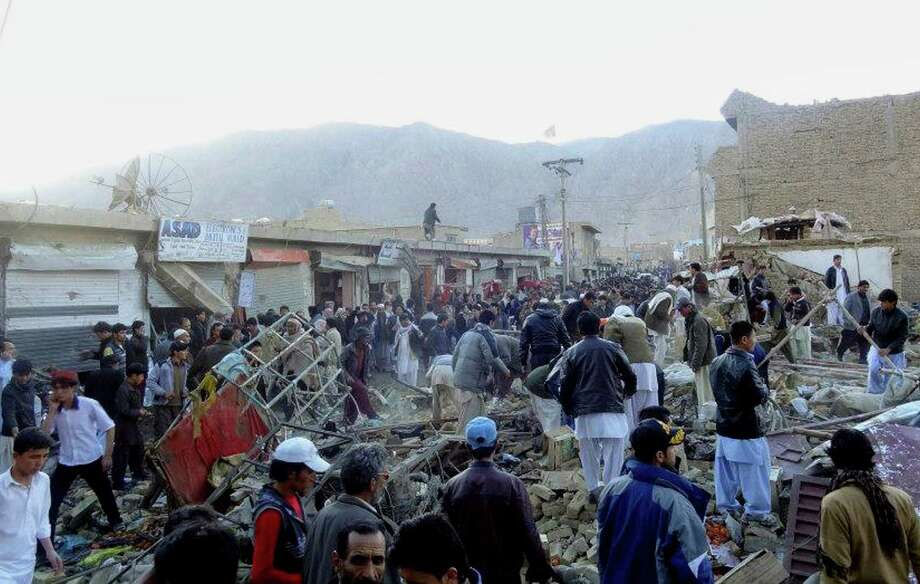 People gather after a bomb apparently targeting Shiite Muslims exploded in a crowded market in the western city of Quetta. Photo: AFP / Getty Images