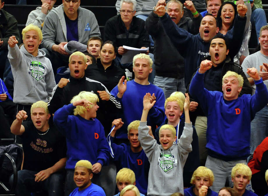 Danbury teammates cheer after Juan Garcia pinned Trumbull's Brandon Fulco, during Class LL wrestling championship wrestling action in Trumbull, Conn. on Saturday February 16, 2013. Photo: Christian Abraham / Connecticut Post