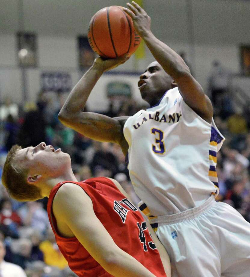 UAlbany's #3 D.J. Evans goes over Hartford's #43 Nate Sikma during Saturday's game at SEFCU Arena in Albany Feb. 16, 2013.  (John Carl D'Annibale / Times Union) Photo: John Carl D'Annibale / 00021154A