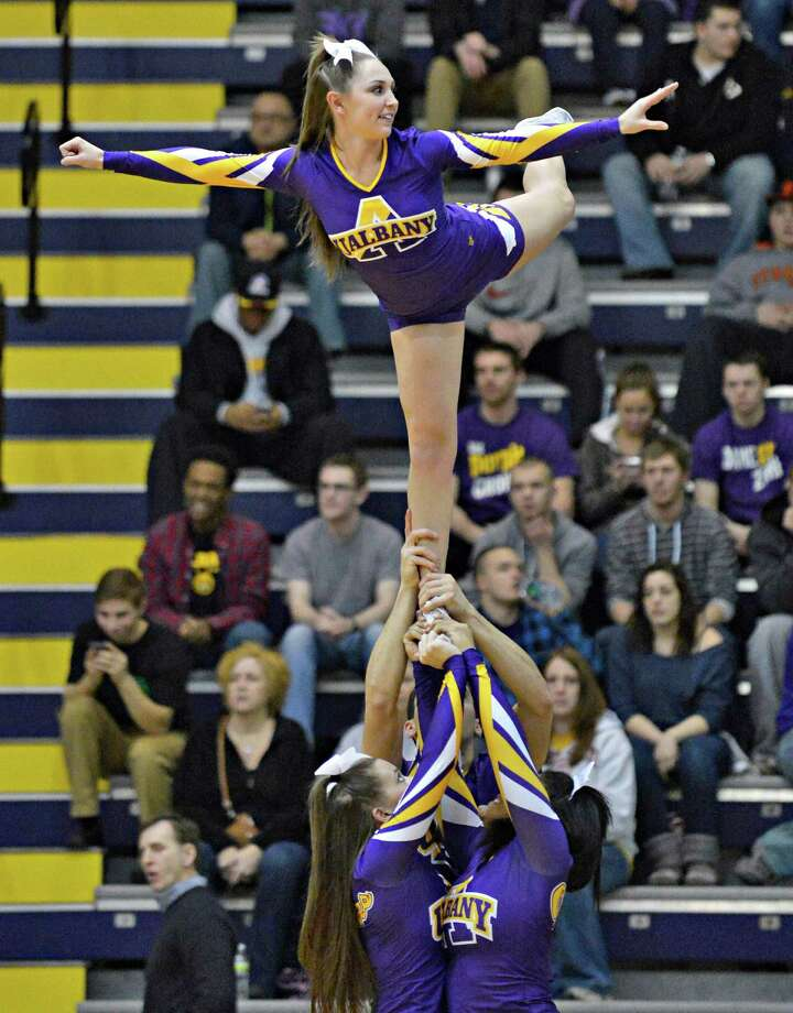 UAlbany chearleader Allie Wagner waves to the crowd during Saturday's game against Hartford at SEFCU Arena in Albany Feb. 16, 2013.  (John Carl D'Annibale / Times Union) Photo: John Carl D'Annibale / 00021154A