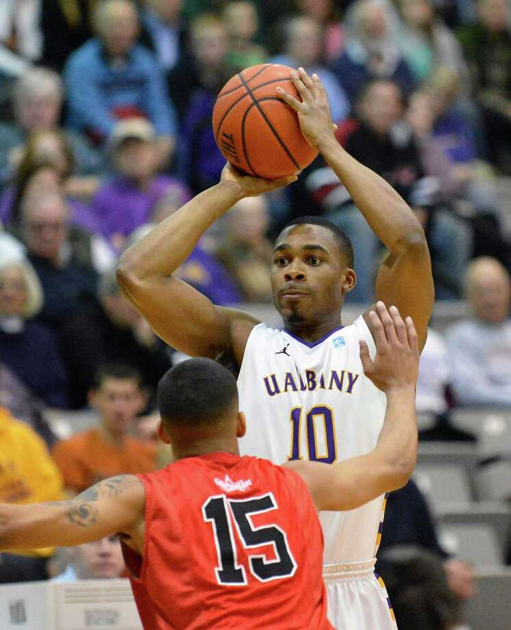 UAlbany's #10 Mike Black gets his shot past Hartford's #15 Yolonzo Moore II during Saturday's game at SEFCU Arena in Albany Feb. 16, 2013.  (John Carl D'Annibale / Times Union) Photo: John Carl D'Annibale / 00021154A
