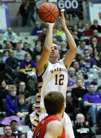 UAlbany's #12 Peter Hooley hits a three pointer during Saturday's game against Hartford at SEFCU Arena in Albany Feb. 16, 2013.  (John Carl D'Annibale / Times Union) Photo: John Carl D'Annibale / 00021154A