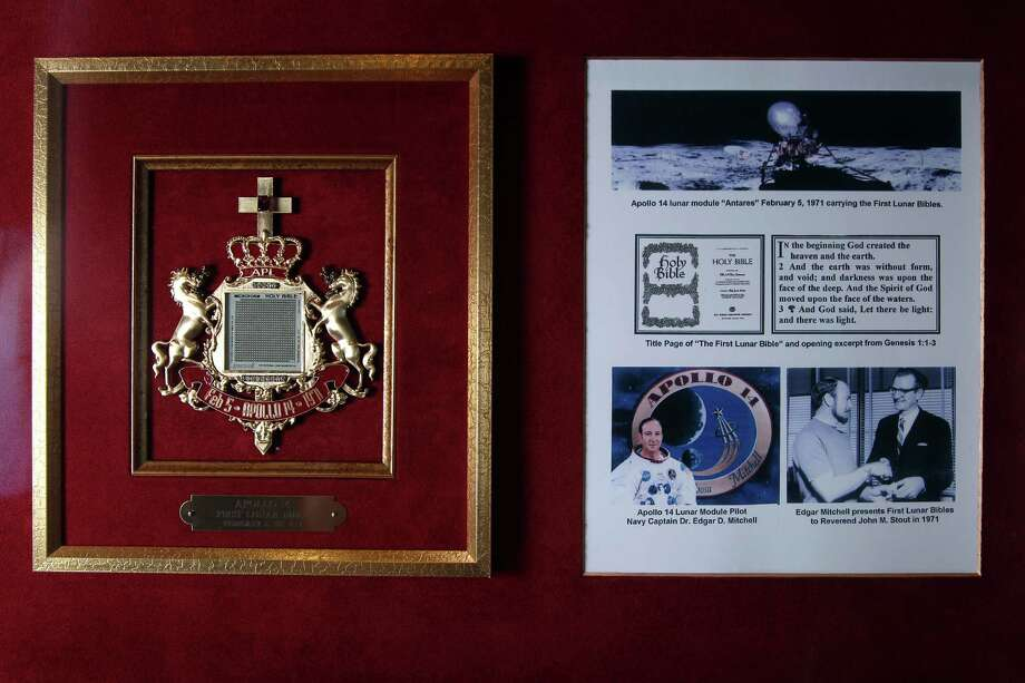 """This """"lunar Bible"""" on display in the Bible Museum at Houston Baptist Church is one of more than 100 microfilm copies of Scripture taken to the moon by Apollo XIV Astronaut Edgar Mitchell, who carried them during his moonwalk on Feb. 5, 1971. Photo: Mayra Beltran, Staff / © 2013 Houston Chronicle"""