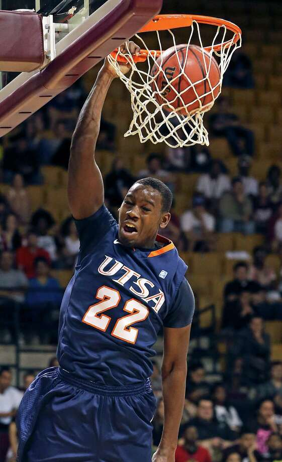 Roadrunner guard Kannon Burrage jams one in the first half as Texas State hosts UTSA in men's basketball at Strahan Coliseum  on February 16, 2013. Photo: Tom Reel, San Antonio Express-News