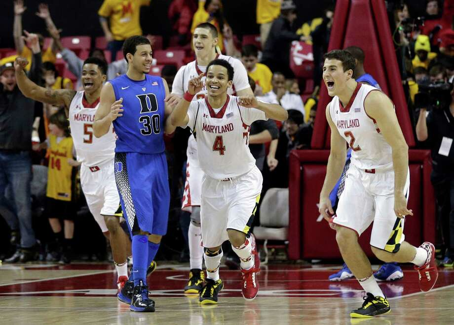 Maryland's Nick Faust (5), Seth Allen (4) and Logan Aronhalt (2) celebrate in front of Duke guard Seth Curry after beating Duke 83-81 in an NCAA college basketball game in College Park, Md., Saturday, Feb. 16, 2013. (AP Photo/Patrick Semansky) Photo: Patrick Semansky