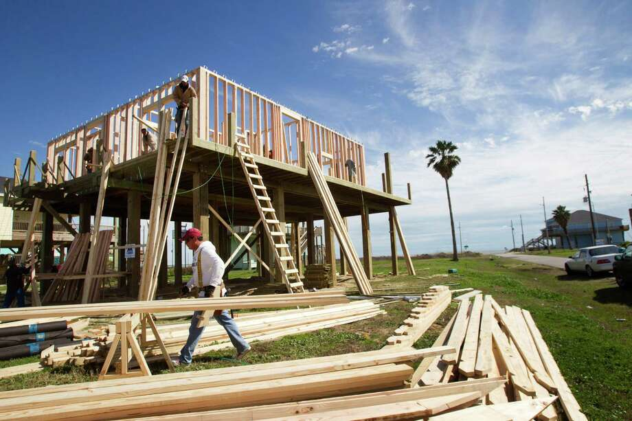 Workers continue construction on a new home on Wednesday, Feb. 13, 2013, in Crystal Beach, Texas. The Bolivar Peninsula is experiencing a comeback after most of the communities were wiped out or severely damaged by Hurricane Ike in 2008. Photo: Brett Coomer, Houston Chronicle / © 2013 Houston Chronicle