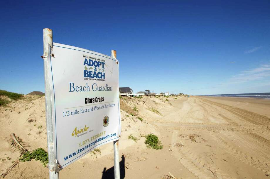 "An ""Adopt A Beach"" sign can be seen Wednesday, Feb. 13, 2013, in Crystal Beach, Texas. Photo: Brett Coomer, Houston Chronicle / © 2013 Houston Chronicle"
