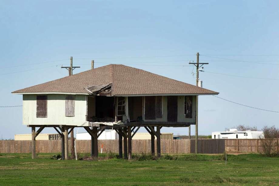 A damaged home sits abandoned Wednesday, Feb. 13, 2013, in Crystal Beach, Texas. Photo: Brett Coomer, Houston Chronicle / © 2013 Houston Chronicle