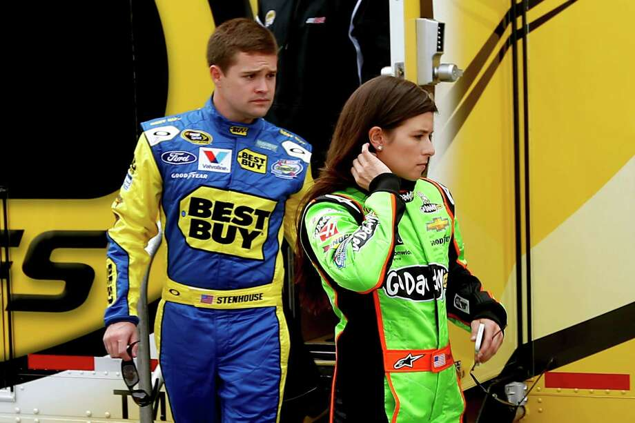 DAYTONA BEACH, FL - FEBRUARY 16:  Drivers Danica Patrick and Ricky Stenhouse Jr. leave a rookie  meeting prior to practice for the NASCAR Sprint Cup Series Sprint Unlimited at Daytona International Speedway on February 16, 2013 in Daytona Beach, Florida.  (Photo by Chris Graythen/Getty Images) Photo: Chris Graythen