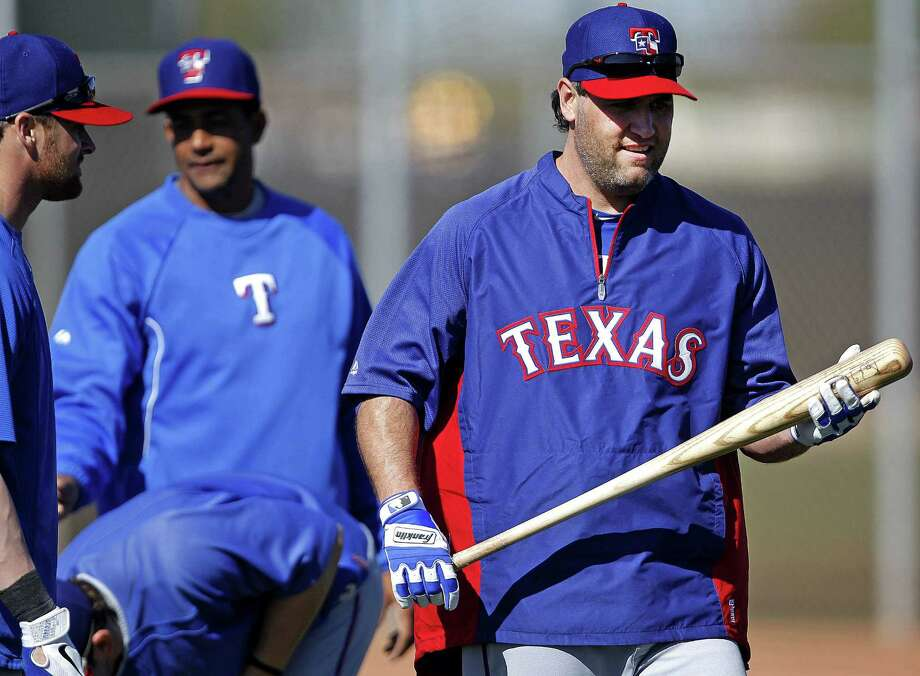 Rangers slugger Lance Berkman (right) takes part in batting practice Saturday during his first spring training with Texas. The 37-year-old New Braunfels Canyon product joins a veteran group looking to win the AL pennant for the third time in four years. Photo: Ron Jenkins / Fort Worth Star-Telegram