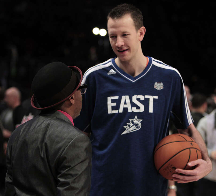Steve Novak of the New York Knicks chats with Spike Lee before competing in the NBA All-Star Three-Point Contest at the Toyota Center on All-Star Saturday Night, Saturday, Feb. 16, 2013, in Houston. Photo: James Nielsen, Houston Chronicle / © 2013  Houston Chronicle