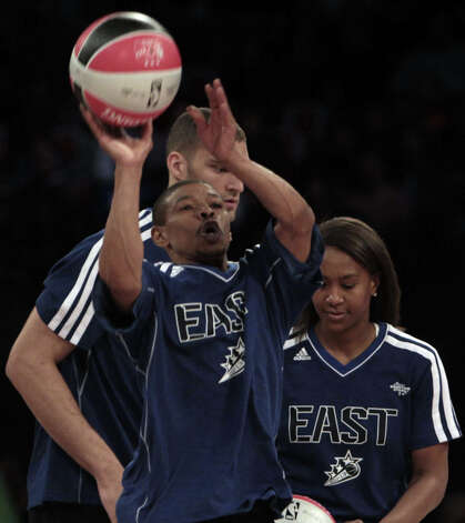 Muggsy Bogues takes a shot during the NBA All-Star Shooting Stars competition at the Toyota Center on All-Star Saturday Night, Saturday, Feb. 16, 2013, in Houston. Photo: James Nielsen, Houston Chronicle / © 2013  Houston Chronicle