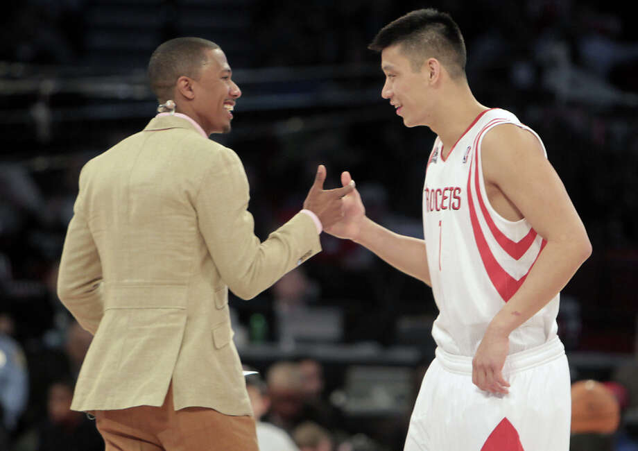 Jeremy Lin of the Houston Rockets greets master of ceremonies Nick Cannon before competing in the NBA All-Star Skills Challenge at the Toyota Center on All-Star Saturday Night, Saturday, Feb. 16, 2013, in Houston. Photo: James Nielsen, Houston Chronicle / © 2013  Houston Chronicle