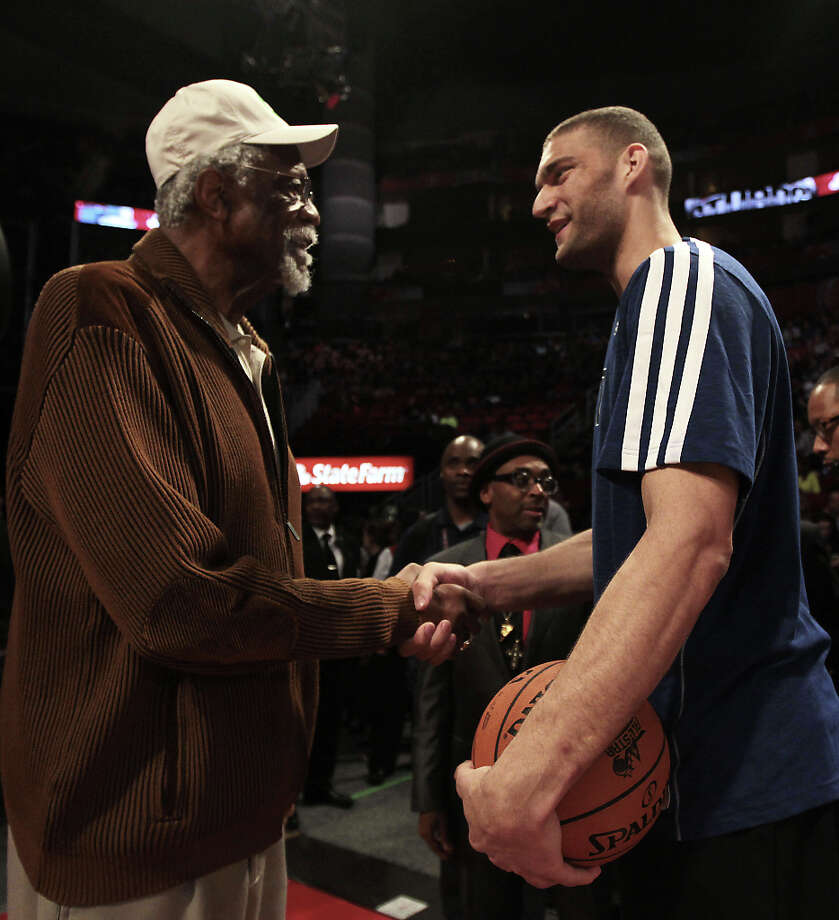 Brook Lopez of the Brooklyn Nets shakes hands with NBA legend Bill Russell before competing in the NBA All-Star Shooting Stars competition at the Toyota Center on All-Star Saturday Night, Saturday, Feb. 16, 2013, in Houston. Photo: James Nielsen, Houston Chronicle / © 2013  Houston Chronicle