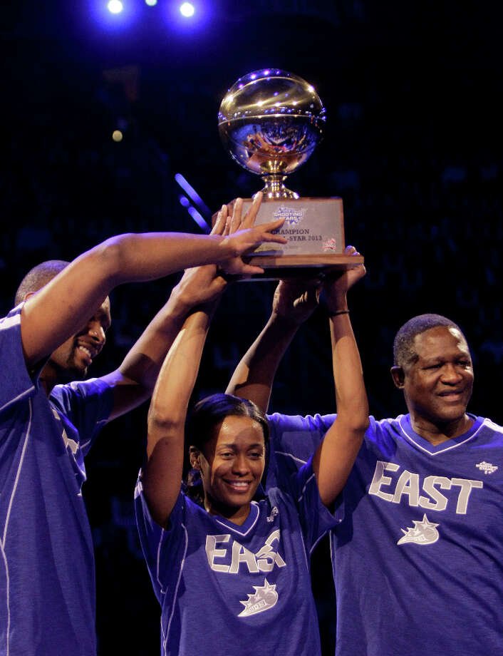 Chris Bosh of the Miami Heat, Swin Cash of the Chicago Sky and Dominique Wilkins celebrate with their trophy after winning the NBA All-Star Shooting Stars competition at the Toyota Center on All-Star Saturday Night, Saturday, Feb. 16, 2013, in Houston. Photo: Melissa Phillip, Houston Chronicle / © 2013  Houston Chronicle
